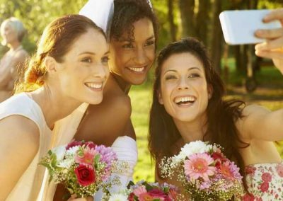 Carrie the bride and two attendants take a selfie at Fox Hills
